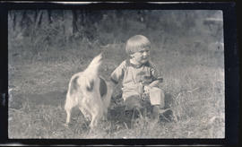 Child playing with Pete the dog