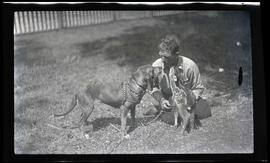 Warden Hadley with a fawn and a dog
