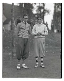 Two golfers on green