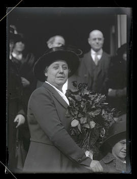 Unidentified woman holding flowers