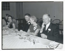 Unidentified people at table during dinner party?
