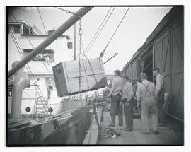 Crate being hoisted onto ship