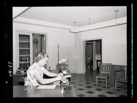 Woman in office with typewriter