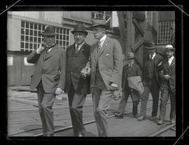 Charles M. Schwab touring shipyard with unidentified officials