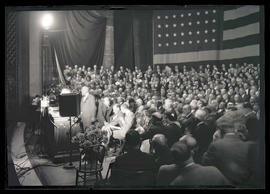 Franklin D. Roosevelt and crowd seated on stage at Portland Civic Auditorium