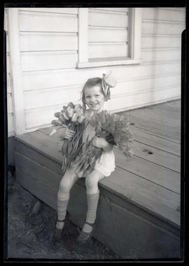Young girl, member of Boulanger family?, holding tulips