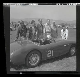 Group of men with sports car at auto races in Tillamook, June 1955
