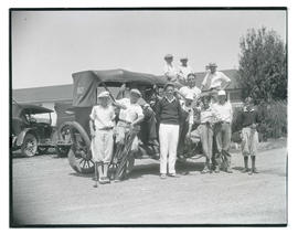Group of young golfers with car