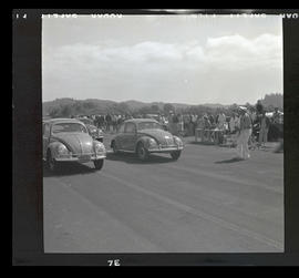 Volkswagen Beetles at starting line for race in Tillamook, June 1955