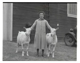Unidentified woman with two goats, probably at Pacific International Livestock Exposition