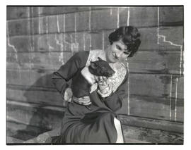 Woman holding piglet
