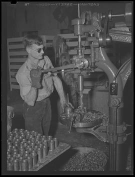 Blind war industry worker with drill press