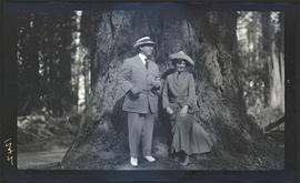 T. Gilbert Pearson and woman standing by a tree
