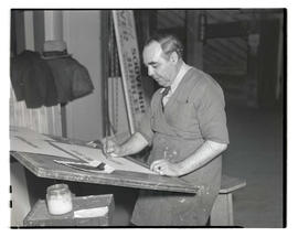 Unidentified man painting sign, probably at Pacific International Livestock Exposition