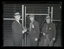 Workers, possibly security employees, on graveyard shift at Albina Engine & Machine Works, Po...