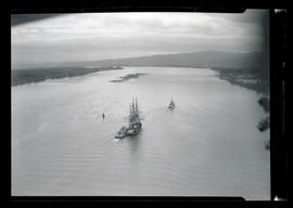 USS Constitution, tugboat Shaver, and USS Grebe under way on Columbia River near Puget Island, Wa...