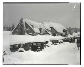 Snow-covered road and cars outside Battle Axe Inn, Government Camp, Oregon