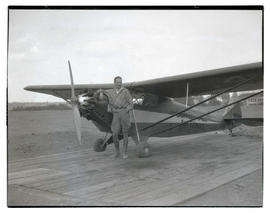 Unidentified man with Bidwell-Yale Air Service plane