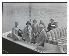 Group of unidentified people on motorboat