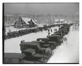Cars lining road near Battle Axe Inn during winter in Government Camp, Oregon
