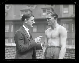 Boxer Ray Pelkey and unidentified man