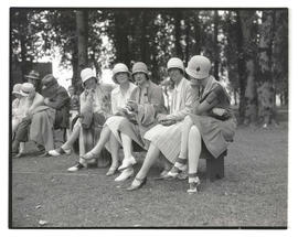 Five golfers seated on bench
