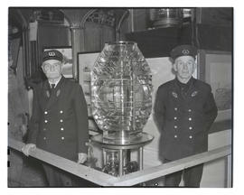 Members of U. S. Lighthouse Service with Fresnel lens, probably at Pacific International Livestoc...