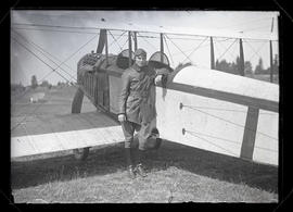 "Unidentified aviator with Curtiss ""Jenny"" biplane"