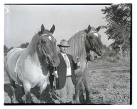 Luther Harrel? posing with horses and trophy