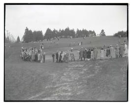 Spectators on golf course at Waverley Country Club, Portland