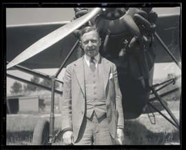 Judge Hall S. Lusk in front of airplane