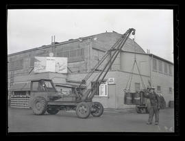 Workers with truck-mounted crane during swing shift, Albina Engine & Machine Works, Portland