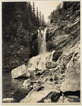 Fishing at base of Trick Falls, Two Medicine River, Glacier National Park
