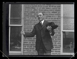 Unidentified man posing with arms outstretched