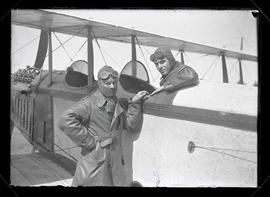 "Two unidentified aviators with Curtiss ""Jenny"" biplane"