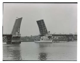 U. S. Navy ship, hull number 145, passing Burnside Bridge, Portland