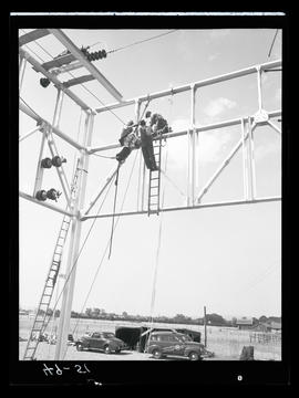 Men on metal structure