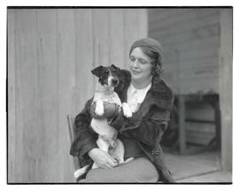 Woman holding dog