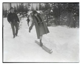 Woman balancing on skis