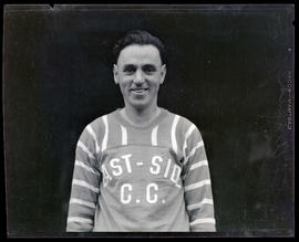 Arcand, wearing East-Side C. C. jersey