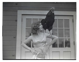 Woman with rooster on shoulder