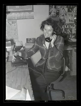 Employee using telephone at Albina Engine & Machine Works, Portland