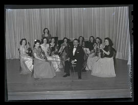 Marylhurst College students and conductor on stage at recital, 1943
