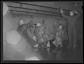 Workers scraping metal at Oregon Shipbuilding Corporation, Portland