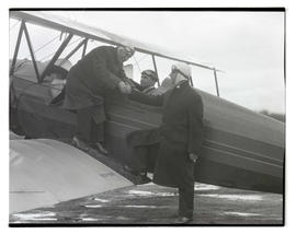 Two unidentified men and Tex Rankin with airplane
