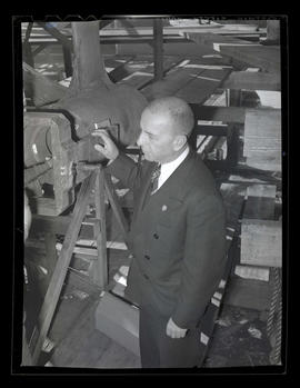 Albina Engine & Machine Works vice president L. R. Hussa looking at ship part?