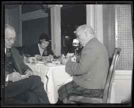 Sir Harry Lauder, his niece, and unidentified man sitting at dining table