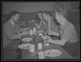 People eating at Columbia Aircraft Industries, employee club
