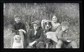 Finley and Morgan children with two dogs and a snake
