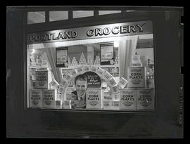 Window display of Kellogg's Corn Flakes at Portland Grocery